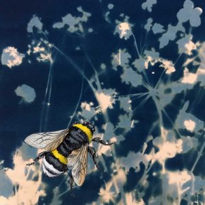 bee on blue floral background